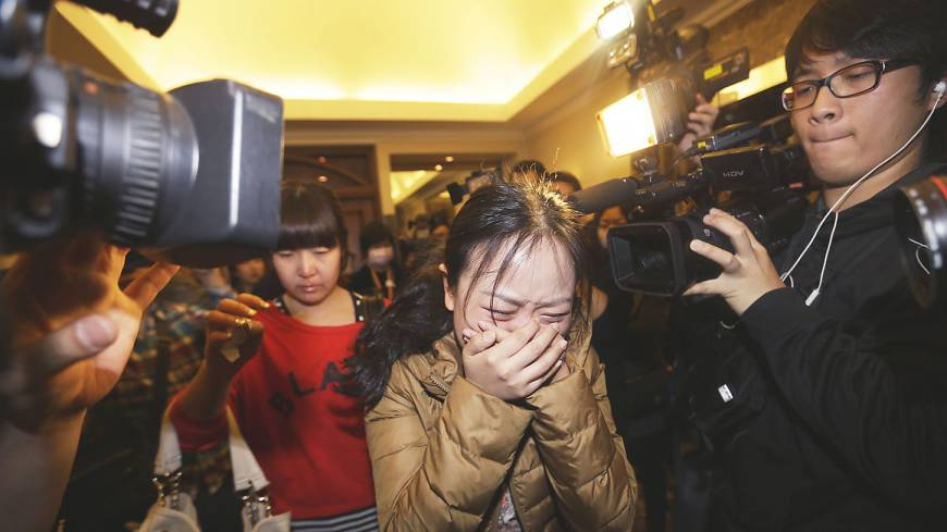 A relative of a Malaysia Airlines flight MH370 passenger breaks down in Beijing on Sunday.
