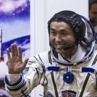 Japanese astronaut Koichi Wakata smiles during a spacesuit test before blasting off for the International Space Station from the Russian-leased Baikonur Cosmodrome in Kazakhstan last Nov. 6. | AFP-JIJI