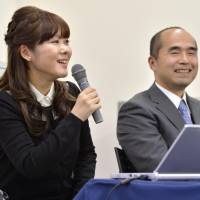 Haruko Obokata of Riken's Center for Developmental Biology speaks at a news conference in January. Next to her is University of Yamanashi professor Teruhiko Wakayama. | KYODO