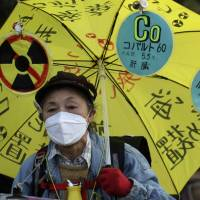 Not fooling around: An anti-nuclear protester marches toward the Diet as part of a demonstration in Tokyo on Dec. 22. | AP