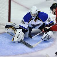 Up close and personal: Chicago's Ben Smith scores past St. Louis goalie Ryan Miller during the Blackhawks' 4-0 win over the Blues on Wednesday. | AP