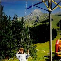 Growing up: Then 6-year-old Haruka Christine enjoys a swinging outside in her native Switzerland.