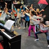 Full on: With musical director Clarissa White on piano, Dale Geyer leads TIP Youth's 8- to 12-year-olds in a rehearsal for their musical, 'Captain Louie Jr.' | YOSHIAKI MIURA