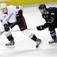Juggling act: Anaheim's Jakob Silfverberg (left) controls the puck as San Jose's Martin Havlat gives chase during the Sharks' 3-2 win on Thursday. | AP