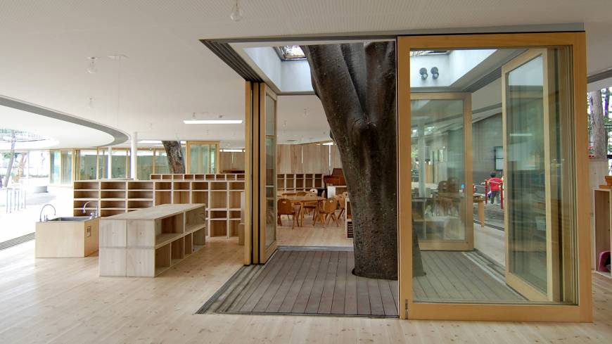 Tree of learning: The inside of Fuji Kindergarten remains open to the outdoors for two-thirds of the year and incorporates three large zelkova trees in its design.