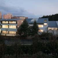 Just like home: Teikyo Elementary School, designed by architect Kengo Kuma, attempts to replicate the look of a traditional row of houses by using wooden facades and sloped roofs. | TAKUMI OTA PHOTOGRAPHY