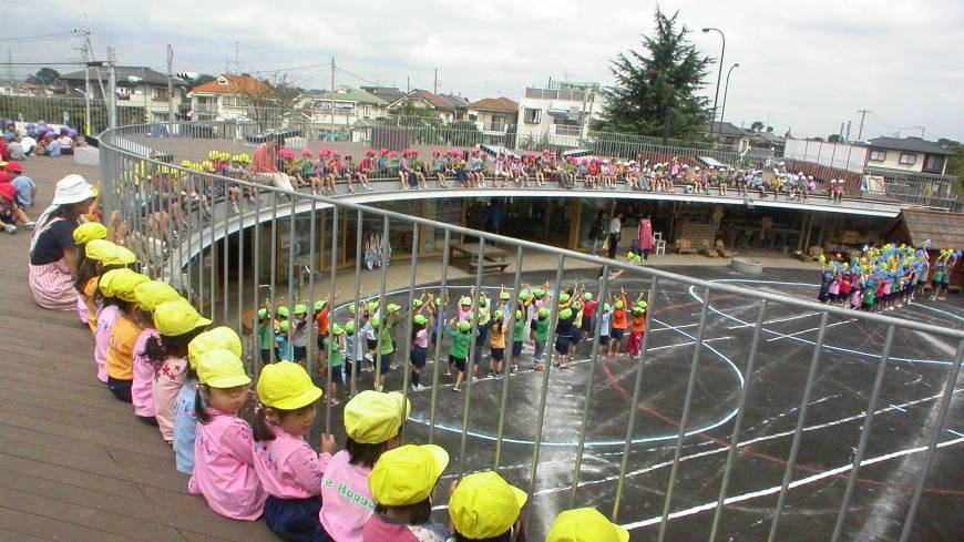 Gather round: Children watch the action below from the roof of Fuji Kindergarten, a preschool designed by Tezuka Architects.