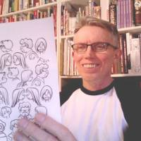 Familiar faces: Japan Times cartoonist Roger Dahl holds up some templates for his long-running 'Zero Gravity' strip at his home in Seattle.   COURTESY OF ROGER DAHL
