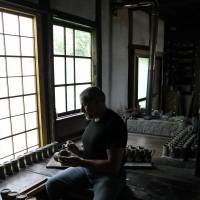 Historic hand-me-down: Euan Craig creates pottery using the wooden kick wheel given to him by the grandson of the late, great potter Shoji Hamada, who was designated a living national treasure. | COURTESY OF EUAN CRAIG