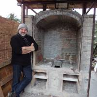 Earthquake-proofed: Euan Craig stands in front of the wood-fired kiln he built from scratch last year. He creates about 400 pots in each firing. | MAMI MARUKO