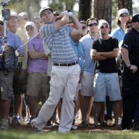 Henley wins playoff; Tiger pulls out