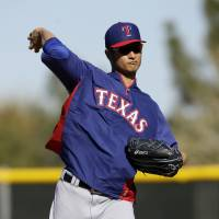 Injured Darvish won't start Rangers' opener