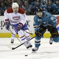 In pursuit: San Jose's Tyler Kennedy moves for the puck ahead of Montreal's Rene Bourque in the first period on Saturday. | AP
