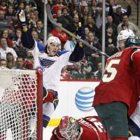 Singing the blues: St. Louis' T.J. Oshie celebrates after scoring against Minnesota on Sunday. | AP