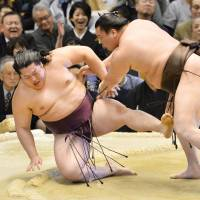 Size and strength: Yokozuna Hakuho overpowers Endo on Tuesday at the Spring Grand Sumo Tournament in Osaka. | KYODO
