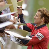 Man of the hour: Diego Forlan signs autographs for Cerezo Osaka fans on Thursday in Osaka. The Uruguay international is in his first season in the J.League. | KYODO