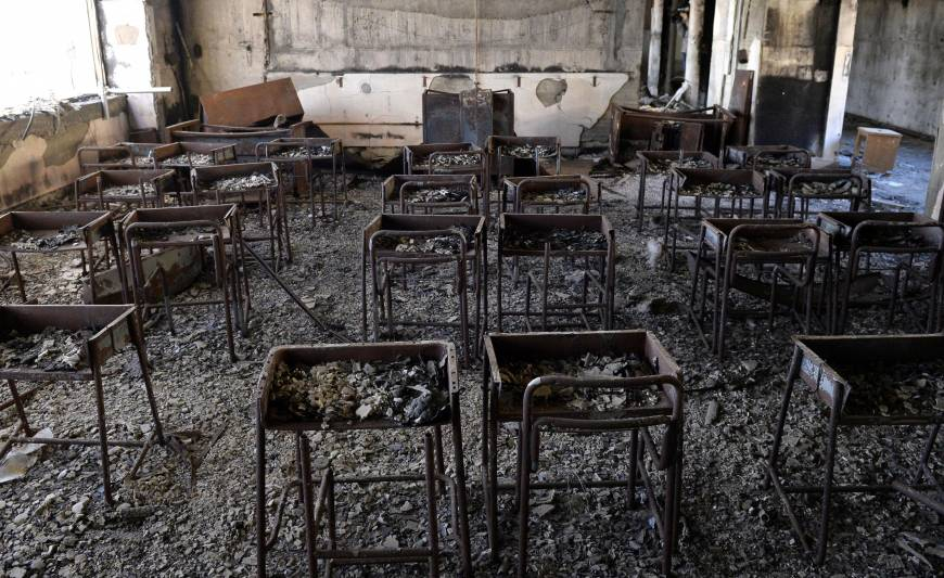 Charred desks and chairs still stand Jan. 22 in a classroom in Kadowaki Elementary School, which was gutted by fire after the March 11 tsunami, in Ishinomaki, Miyagi Prefecture.