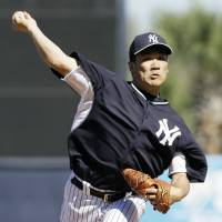 Impressive: New York's Masahiro Tanaka fires a pitch against Philadelphia in the fifth inning of a spring training game on Saturday. | AP