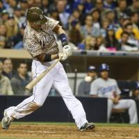 Back in business: Padres outfielder Chris Denorfia connects on a two-run single against the Dodgers during the eighth inning on Sunday in San Diego. The Padres rallied for a 3-1 win. | AP