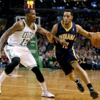 Slow down: Indiana's Evan Turner drives on Boston's Chris Johnson in the first half on Saturday night. The Pacers ran past the Celtics 102-97. | AP