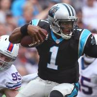 Late move: Carolina Panthers QB Cam Newton will undergo surgery on his left ankle and be sidelined for four months while rehabbing, the team announced on Tuesday. | AP