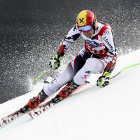 King of the hill: Austria's Marcel Hirscher competes in the World Cup giant slalom finals on Saturday in Lenzerheide, Switzerland. Hirscher finished fourth but claimed his third overall title. | AFP-JIJIS