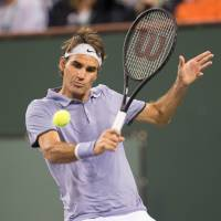 On a roll: Roger Federer hits a return against Kevin Anderson during their quarterfinal match at the BNP Paribas Open on Thursday in Indian Wells, California. Federer won 7-5, 6-1. | AFP-JIJI