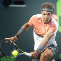 Relentless: Rafael Nadal plays a shot from Uzbekistan's Denis Istomin in their third-round match at the Sony Open on Monday in Miami. Nadal won 6-1, 6-0. | AP