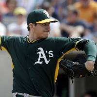 Big blow: Jarrod Parker, projected as the No. 1 starter for the Oakland Athletics in 2014, will miss the entire season due to a second Tommy John surgery on his right elbow. | AP