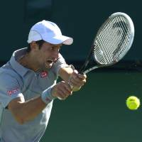 Djokovic holds off Federer in BNP Paribas Open final