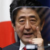 Prime Minister Shinzo Abe speaks while looking at a teleprompter during a news conference at his official residence Thursday. | AP