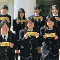 Takagi Gakuen Girls' High School students pose with Cheerio ice cream, which they developed with Morinaga Milk Industry Co., in Yokohama. | KYODO