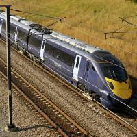 A 'Javelin' high-speed train built by Hitachi Ltd. travels between Ashford, Kent, and London's St. Pancras station in 2009. Hitachi is hoping to expand its business in Europe. | BLOOMBERG