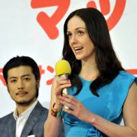 American Charlotte Kate Fox speaks at a news conference Tuesday in Tokyo about the new NHK drama 'Massan,' in which she will play a leading role, as actor Tetsuji Tamayama looks on. | YOSHIAKI MIURA