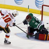 He's on fire: The Flames' Corban Knight scores past Stars goalie Tim Thomas on Friday. | AP