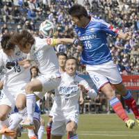 This is easy: Marinos' Sho Ito (right) heads the ball in traffic near the Vortis goal during Yokohama's 3-0 win over Tokushima on Saturday. | KYODO