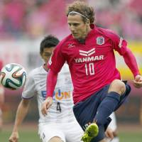 Off and running: Cerezo Osaka's Diego Forlan kicks the ball during his