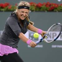 Feel the burn: Victoria Azarenka plays a shot during her 6-0, 7-6 (7-2) defeat to Lauren Davis at Indian Wells on Friday. | REUTERS