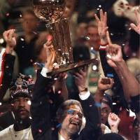 All I do is win: Phil Jackson celebrates NBA titles in Chicago in 1996 (right) and 1997 (left) and Los Angeles (2000). Jackson has reportedly agreed to join the Knicks front office. | AP