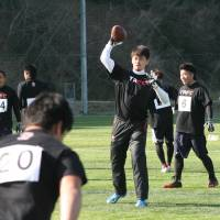Follow the leader: Tomotsuna Inoue makes a pass during a practice session at the Tomotsuna Academy Football Camp. Inoue hopes to one day help a Japanese player break into the NFL. | KAZ NAGATSUKA