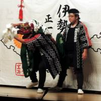 A group from a disaster-hit community in Iwate Prefecture performs the 'kagura' traditional dance at an event in Chiyoda Ward, Tokyo, on Dec. 20. | CULTURAL AFFAIRS AGENCY / KYODO