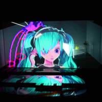 Virtual idol Hatsune Miku is projected onto a screen during a performance of 'The End' at Théâtre du Châtelet in Paris in November. | YKBX/CRYPTON FUTURE MEDIA INC./LOUIS VUITTON/KENSHU SHINTSUBO