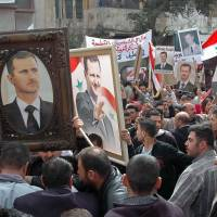 Despite ongoing civil war, Assad readies for election