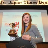 Michaella Bostrom, 14, holds up her trophy after winning the 5th Japan Times Spelling Bee at the newspaper's headquarters in Minato Ward, Tokyo, on Saturday.  | YOSHIAKI MIURA