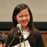 Yuka Saiji, 14, from the International School of the Sacred Heart Tokyo, struggles to recall a spelling.  | YOSHIAKI MIURA