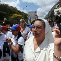 Venezuelans protest against the government in Caracas on Wednesday. | AFP-JIJI