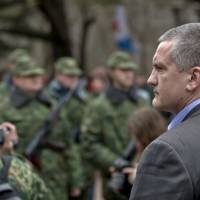 Crimea Premier Sergey Aksyonov attends the swearing-in ceremony for a pro-Russian armed force in Simferopol on Saturday. | AP