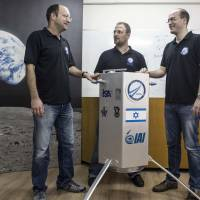 SpaceIL co-founders (from left) Yariv Bash, Kfir Damari and Yonatan Winetraub pose with their spacecraft prototype at Bar-Ilan University, near Tel Aviv, on Feb. 24. | REUTERS