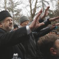 Loyal to Ukraine, Muslim Tatars in Crimea lie low as Russia seizes region