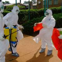 West Africa battles Ebola; traveler confined in Canada